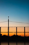 The sun goes down over the urban landscape Stock Image