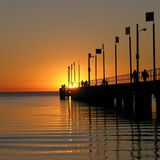 Sun goes down on the pier. The sun going down at Frankston pier, on the Mornington Peninsula region of Victoria, Australia Stock Image