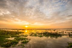 Evening at the reservoir. The sun goes down at a reservoir in Thailand Stock Images