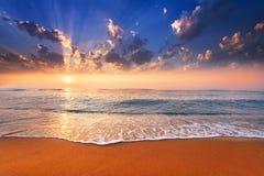 Sun goes down at sea. Royalty Free Stock Image