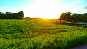 Sun going down in landscape Stock Images