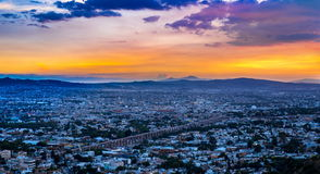 Sun going down over the city of Queretaro Mexico. The aqueduct of Queretaro, is currently building a monumental 74 arches reaching an average height of 28. 5 m stock photography