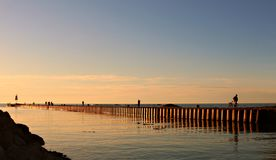 Twilight sky over Lake Huron in Kincardine Canada with people walking on pier royalty free stock photography