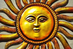 Sun. The golden sun with a face. A garden ornament stock photo
