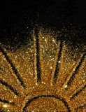 The sun of golden glitter sparkle on black background Royalty Free Stock Images