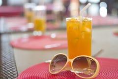 Sun grass orange juice. On vacation Stock Photos