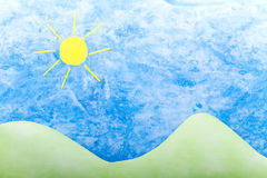 Sun, green hills and blue sky handmade Royalty Free Stock Image
