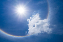 Sun halo with cloud in the sky. Photo of Sun halo with cloud in the sky Royalty Free Stock Image
