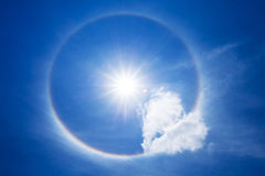 Sun halo with heart cloud in the sky Royalty Free Stock Image