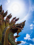 Sun halo on the king of Nagas and blue sky Stock Image