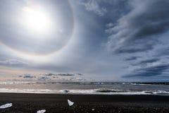 Sun halo on the shore. Of Jokulsarlon glacier lagoon Stock Photos