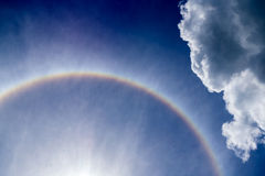 Sun halo. Some part of the sun halo in the sky with clody Stock Photo