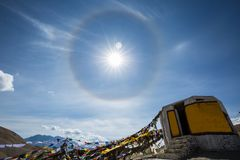 Sun Halo. Over prayer flag on the way to Leh, India royalty free stock photography