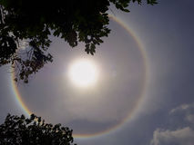 Sun halo. The sun sways around the rainbownSun halo with cloud in the sky royalty free stock image