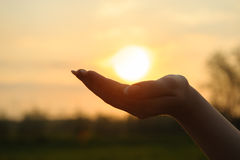 The sun in hand Royalty Free Stock Photo