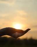 The sun in hand Stock Photography