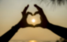 The sun on hand of couple in blur style Royalty Free Stock Images