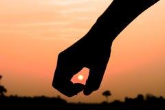 Sun in hand. Sun in the hand on sunset Stock Photos