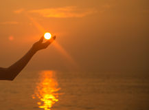 Sun in hand sunset over the beach Royalty Free Stock Photos