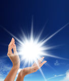 Sun in the hands Royalty Free Stock Photo