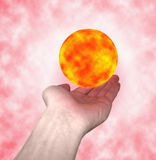 Sun in hands. The flaming sun in the hands royalty free stock photos