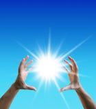 Sun between the hands. Freedom concept