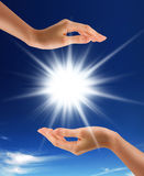 Sun between the hands. Royalty Free Stock Images