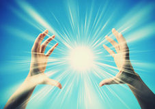 Sun between the hands. Stock Photos