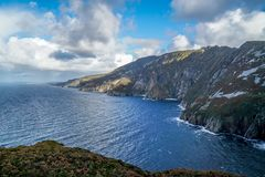 The Sun has Burned Off Most Of the Fog. The sun has burned off most of the morning fog from the Slieve League Cliffs in Donegal County Ireland Stock Images