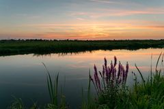 The sun has set over the dutch polder landscape, close to Gouda, Holland royalty free stock photography