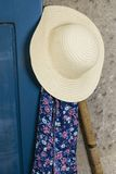 Sun hat, apron and spade Royalty Free Stock Images