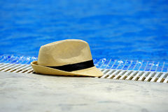 Sun hat on the edge of the pool Royalty Free Stock Image