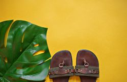 Sun hat glasses and flip flops stock images