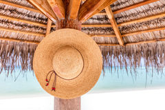 Sun hat hanging on sunshade umbrella on tropical beach. Maldives. Sun hat hanging on sunshade umbrella on tropical beach. Indian Ocean, Maldives Royalty Free Stock Photography