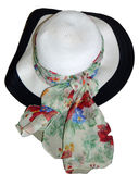 Sun hat with sash. A flexible straw sunhat decorated with a flowered sash Stock Photos