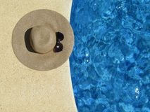 Sun Hat and Shades by the pool Royalty Free Stock Image