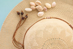 Sun hat. With shells on blue background Royalty Free Stock Images
