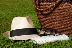Sun hat with sunglasses on meadow Royalty Free Stock Images