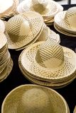 Sun Hats on Display in a French Market Stock Photography