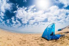 Sun-Haube auf einem Strand Lizenzfreies Stockbild