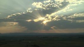 Sun hidden behind clouds stock footage