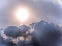 The sun hiding behind the clouds Royalty Free Stock Images