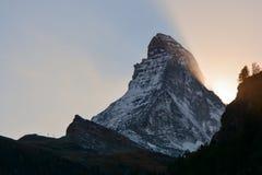 Sun hiding behind the Matterhorn Stock Image