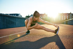 Sun highlights young muscular female athlete Royalty Free Stock Photo