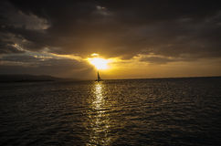 Sun hits a boat in the caribbean Royalty Free Stock Images