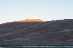 Sun Hitting the Sand Dunes Royalty Free Stock Photography