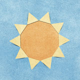 Sun hole ripped in recycled paper craft Royalty Free Stock Images