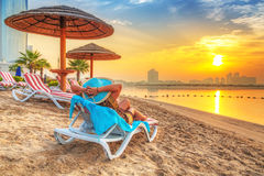 Sun holidays on the beach of Persian Gulf. At sunrise Royalty Free Stock Images