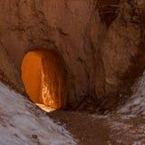 Sun Through Hoodoo Tunnel in Winter Stock Photography