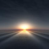 Sun on Horizon over rippled water. Royalty Free Stock Image